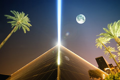 Once in a Blue Moon 2010 (Lee Sie) Tags: trees light moon reflection glass night nikon triangle angle pyramid wide luna palm fullmoon beam peacesign luxor happynewyear sigma1020mm d40 nikkor70200mm
