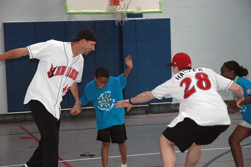 Chris Bootcheck and Eric Hacker of the Indianapolis Indians play with kids from The Salvation Army Daycamp.