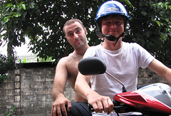Benno with a half naked man on the back of his bike