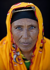Gabbra woman - Kenya (Eric Lafforgue) Tags: africa woman blur face yellow canon eyes dof veil kenya blueeyes femme muslim culture tribal elder tribes afrika trad