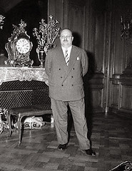 H.M. King Farouk of Egypt Poses In His Hotel Suite After His Arriving To Paris From The Riviera - April 28, 1953 (Tulipe Noire) Tags: paris france europe king egypt farouk 1950s egyptian 1953
