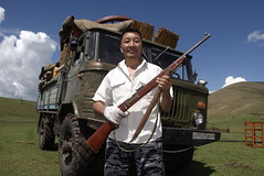 TRUCKING IN MONGOLIA (Claude  BARUTEL) Tags: portrait army gun russia gaz 66 made mongolia driver trucks trucking steppe riffle