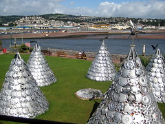The tribe wholeheartedly embraced modern technology (bobfranklin) Tags: holiday seaside recycled sixwordstory devon teepee ness windpower wigwams hubcaps teignmouth shaldon