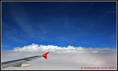 Above the clouds (Vivek Dikshit) Tags: blue red sky india white fog clouds plane flight wing aeroplane kingfisher indore mumbai canon1000d vivekdikshit