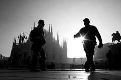 Open your eyes to a new day (Donato Buccella / sibemolle) Tags: street blackandwhite bw italy man milan backlight sunrise alba milano streetphotography flare duomo controluce domani lowangle 18mm dalbasso canon400d sibemolle unalbadilucemeravigliosa