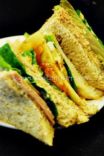 Chicken slice, cheese and tuna sandwich