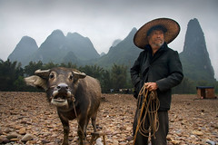 Yangshuo Farmer & Water Buffalo (An diabhal glas) Tags: china river landscape li republic peoples farmer prc  peaks karst region waterbuffalo zhuang guangxi  autonomous yngshu guangxiprovince  zhnggu guln  xin
