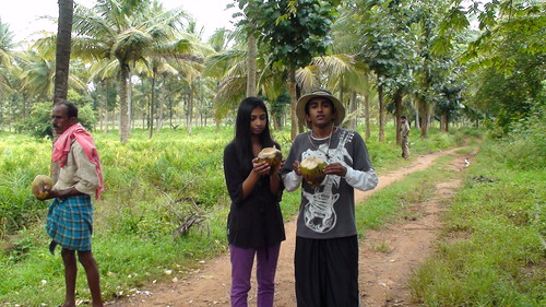 Adarsha & Apoorva drinking tender coconut after hard work by Project Jatropha.