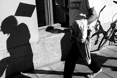 . (ngravity) Tags: street shadow bw man canon blackwhite sweden stockholm candid flag streetphotography nocrop stermalm eos50d makrygiannakis