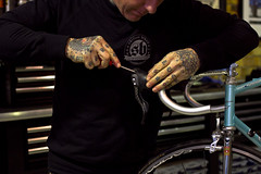 MEL_012 Hard Luck (John Prolly) Tags: melbourne tattoos mechanic 8ball roadbike casati shifterbikes
