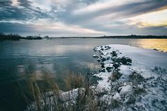 Cold Front (JLDMphoto) Tags: nikon d7200 1685mm cc0 water sunset coldfront storm stormfront snow rocks lake dike blue kansas landscape nature winter