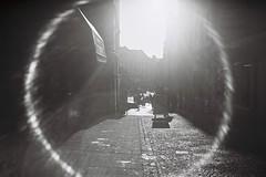 Street Flare (bigalid) Tags: film 35mm plastic hanimex 35se kodak bw400cn expired bw c41 2017 dumfries january lensflare flare sun