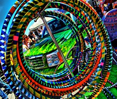 Hula Hoops (Ken Yuel) Tags: hulahoops supershot colorsoftherainbow canadadaycelebrations omot digitalagent canon5dmkii streetsofwinnipeg thehulahoop kenyuel osbornestreetfestival2009 yourmorningwakeupcall