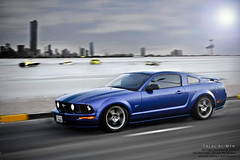 Ford Mustang (Talal Al-Mtn) Tags: blue light orange sun motion ford yellow clouds rebel shot great gear manual mustang 20 gt rim fordmustang v8 2007 xsi mustanggt gt500 fordmustanggt 450d shellby canon450d inkuwait paninng superchaged talalalmtn  bytalalalmtn mustanginmotion mustanginkuwait