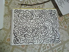 curly lines drawn with a stick
