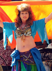 Kira (Flan de Coco) Tags: blue ladies red music orange woman sexy green beautiful beauty smile yellow musicians drums gold fan eyes colorful texas veil dancers arms coins lace vibrant tx swing trf belly tummy twirl shake faire bellydance swirl renfaire lovely performers 2009 renaissance renfest jingles skirts veils shimmy fandance entertainers texasrenaissancefestival veildance hairflower pirateadventure toddmission gypsydancetheatre gysy gypsydancetheater agorastage greekstage gyspydance gypsybreakfast