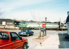 Westbound Burlington Northern / early Metra commuter local. Hindsdale Illinois. October 1989.