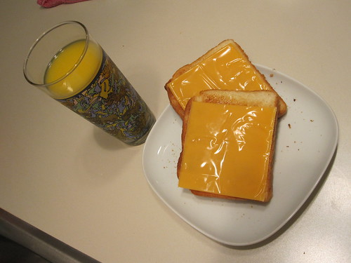 Cheesy toasts and OJ - from groceries