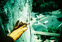 she's got you high (weloveunicorns) Tags: street trip light summer urban reflection film window colors 35mm canon xprocess kodak crossprocess slidefilm crossprocessing gaudi cannon vero elitechrome kodakelitechrome canoneos500n paseodegracia canon500n