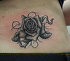 rose tattoo on back Tattooed by Johnny