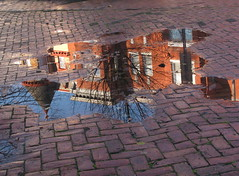 """Puddle-wonderful"" (Kurlylox1) Tags: red house brick rain puddle poetry victorian bluesky neighborhood sidewalk turret capitolhill eecummings puddlepicture"