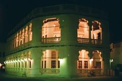 doha, qatar building at night (semievilsquirrel) Tags: 35mm nighttime minoltasrt101 colorfilm