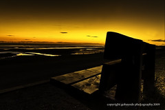 glow (gobayode photography...times) Tags: reflection nature bench glow sunsetglow warmcolours naturalcolours emptybeach sunsetcolours beachbench aplacetobe emptinessatsunset benchatsunset lightonbench areflectionofemptiness