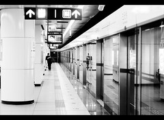Twin reader (davidfattibene) Tags: china people urban bw subway metro beijing lifestyle nikkor 50mmf14d bncitt sanyuanstation