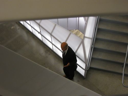 Former MAS president Kent Barwick kicks it in the iconic stairway of the new Cooper building.