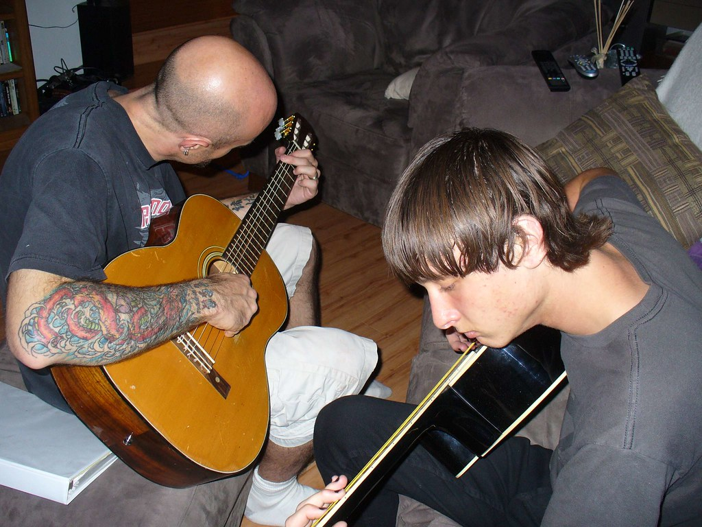 Josh and Andrew play guitar