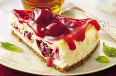 Razzle-Dazzle Berry Cheesecake Recipe (Betty Crocker Recipes) Tags: red party holiday cheese guests crust recipe dessert baking strawberry sweet cheesecake creamy topping entertaining bakedgoods bettycrocker gooey grahamcracker mintleaves bettycrockerrecipe razzledazzleberrycheesecake