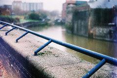 Hanging over a bridge (maggyvaneijk) Tags: fiction colour film wall writing bristol grey focus minolta bokeh story rainy barrier grainy shortstory lear broadmead xge