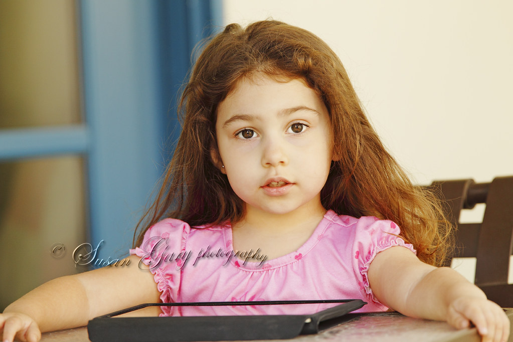 Toddler Girl with Electronic Reading Device