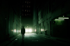 Dark City (Dylan-K) Tags: road street city fiction light shadow cinema reflection building guy green car silhouette night trash photoshop dark movie walking photography office scary nikon noir moody time candid character attack sydney australia science headlights bin alleyway massive midnight rubbish scifi headlight cbd block blade cinematic runner looming darkcity lurking suspect