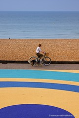 Cyclist and circles on the beach (creativebloke) Tags: brighton tamronspaf1750mmf28xrdiiildasphericalif canoneos50d mikegriggs mikegriggsphotography httpwwwcreativeblokecom