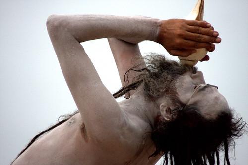 A Saddhu Blows A Conch At Dawn, Varanasi