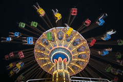 Fair Swing, SuperEx, Ottawa (Marie-Marthe Gagnon) Tags: city carnival light ontario canada black colour up blackbackground night fun chains high neon ride expo chairs background ottawa capital wide citylife fast wideangle fair exhibition swing 400 geometrical 55 posterproject superex flickrchallengegroup flickrchallengewinner bestcapturesaoi mariegagnon mariemarthegagnon elitegalleryaoi mariemgagnon