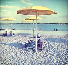 Umbrella (Mute*) Tags: park toronto beach umbrella relax sand chair lakeontario muskoka hto canonef85mmf18usm