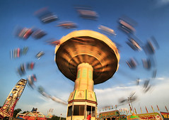 Spinning (` Toshio ') Tags: longexposure summer people motion colors fun fairgrounds moving colorful ride bright action swings maryland fair baltimore swinging timonium toshio marylandstatefair wellenflieger waveswings superaplus aplusphoto platinumheartaward