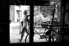 If you were mine (Donato Buccella / sibemolle) Tags: street blackandwhite bw italy milan girl bike bicycle bar model candid milano streetphotography kronan sagostino canon400d sibemolle passatamentreaspettavoqualcunochepassasse fotografiastradale barbacco