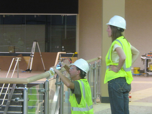 Camille Utterback and Alan H. Davidson installing touch sensitive handrail for interactive light work.