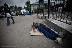 Drunk in Kyzyl (Mieszko Stanislawski) Tags: street city sleeping urban beer drunk bottle russia sleep capital social alcoholism problem siberia alcohol drunken vodka addiction addict tuva syberia whitehair rosja russianfederation tuwa kyzyl araga