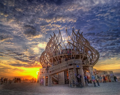 Burning Man 2009 Temple Sunrise (Michael Holden) Tags: morning sky sculpture art festival clouds sunrise temple fire dawn nikon desert fav50 nevada evolution playa fav20 burningman nv blackrockcity burning installation brc dust fav30 hdr highdynamicrange alternative counterculture blm gerlach subculture blackrockdesert fav10 photomatix fav100 fav40 fav60 d80 fav110 fav90 michaelholden fav80 fav70 fav120 templeofremembrance michaelholdencom burningman2009 davidumlas hdrcreativeshots blackrockcity2009 brc2009 marrileeratcliffe bman09 bm09 fireoffires brc09 burningman:art=430 bman2009