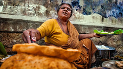 Let's eat on the street • Madurai City Life (Henk oochappan) Tags: life street city people food india kitchen canon eos daily ef1635mmf28lusm 2009 madurai tamil tamilnadu southindia puri poori indianwomen canoneos5d oochappan indianphotography lifeinindia tamilwoman tamillifeculture tamilwomen tamilnadulifeculture maduraicitylife img0243b