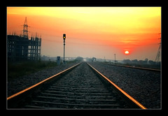 Sun Set (jas-B) Tags: sunset sun lamp electric train evening construction nikon track pole wires 1855mm milestone boora d40 jasbir signle