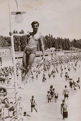 1940s man in speedo briefs cut swim tunks atop light pole at pool shirtless (Christian Montone) Tags: shirtless man men pool briefs 1940s swimtrunks vintagephoto underwearandswimwear