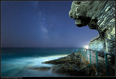 La scogliera degli spettri - Cliff of the ghosts (Andrea Moro) Tags: sea sky italy night landscape nikon rocks italia mare liguria ghost cielo ghosts rocce fantasma notte paesaggio milkyway scogli scogliera levante zoagli tigullio fantasmi spettri vialattea nikkor1735 golfodeltigullio d700 belinspa liberamentefotografia scattifotografici
