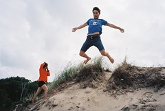 Indiana Dunes. Kevin. (Michael Heck) Tags: park boy chicago flying illinois big jump sand michigan dunes dune indiana blueberry leap culvers picking oventroubleschicago kidspilsenillinoiscookingblueberrypieadventure