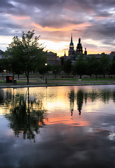 Reflecting Montreal (` Toshio ') Tags: pink sunset summer canada storm reflection building tree water colors rain silhouette architecture clouds buildings montreal ripple bank stormy canadian oldmontreal curve toshio mywinners platinumheartaward hdrcreativeshots