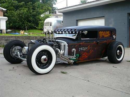 the car is all ford including a 210 hp flattie with 3 strombergs rat rod